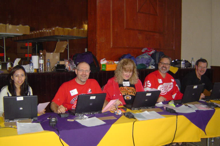 Dan & team at the reception desk of the eye clinic.