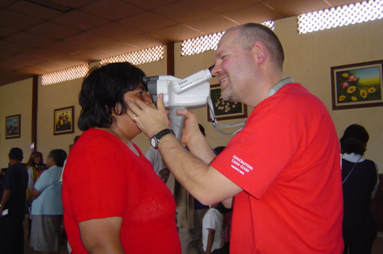 Dan testing a patient's eyes.