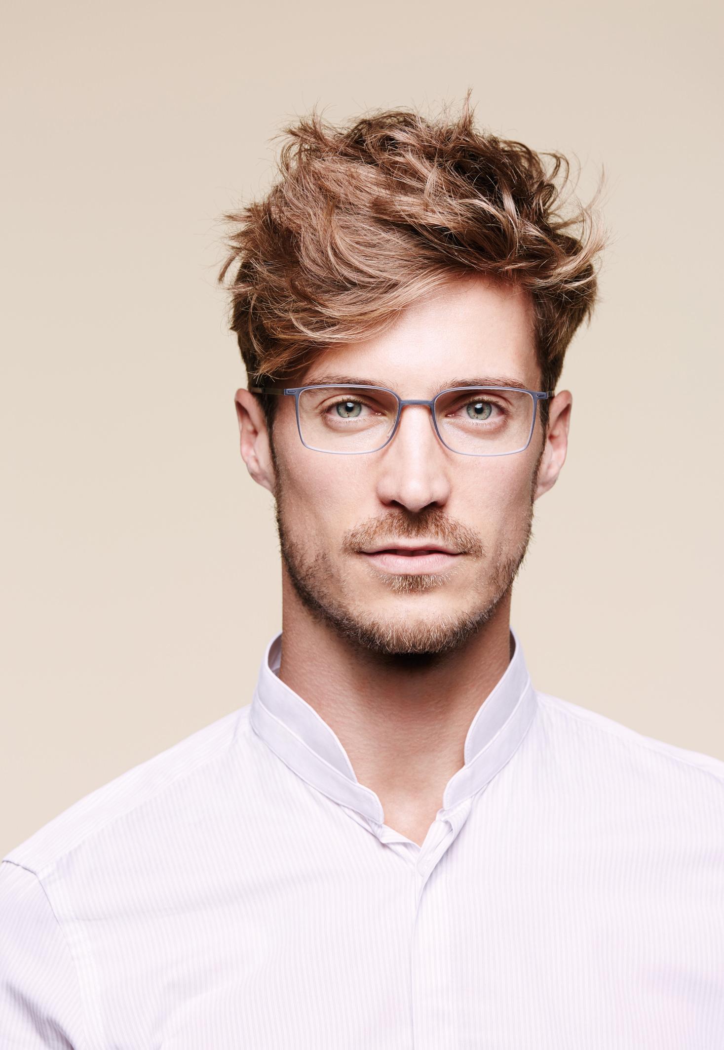 Man wearing Silhouette Urban Lite 2884 plastic eyeglass frames in smoke gray/navy.