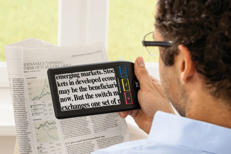 Man reading newspaper using SmartLux Digital.