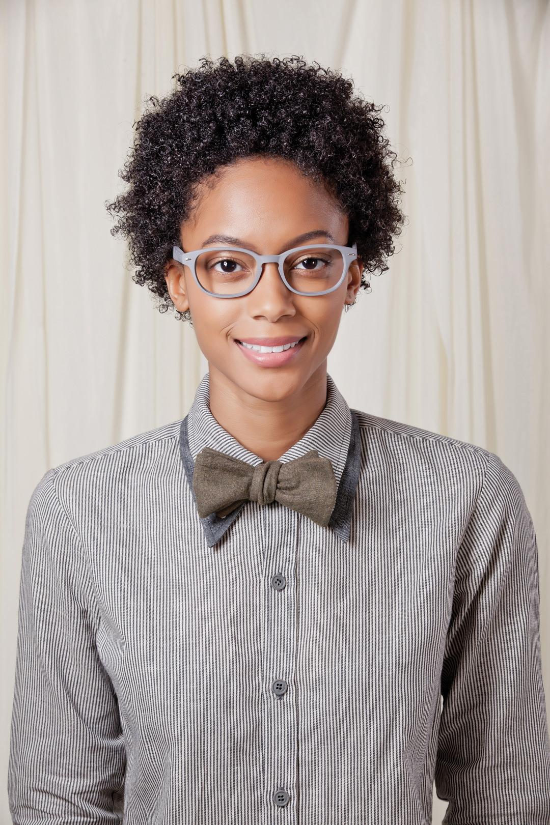 Woman wearing Brooklyn Spectacles Billyburg eyeglasses in Gray.
