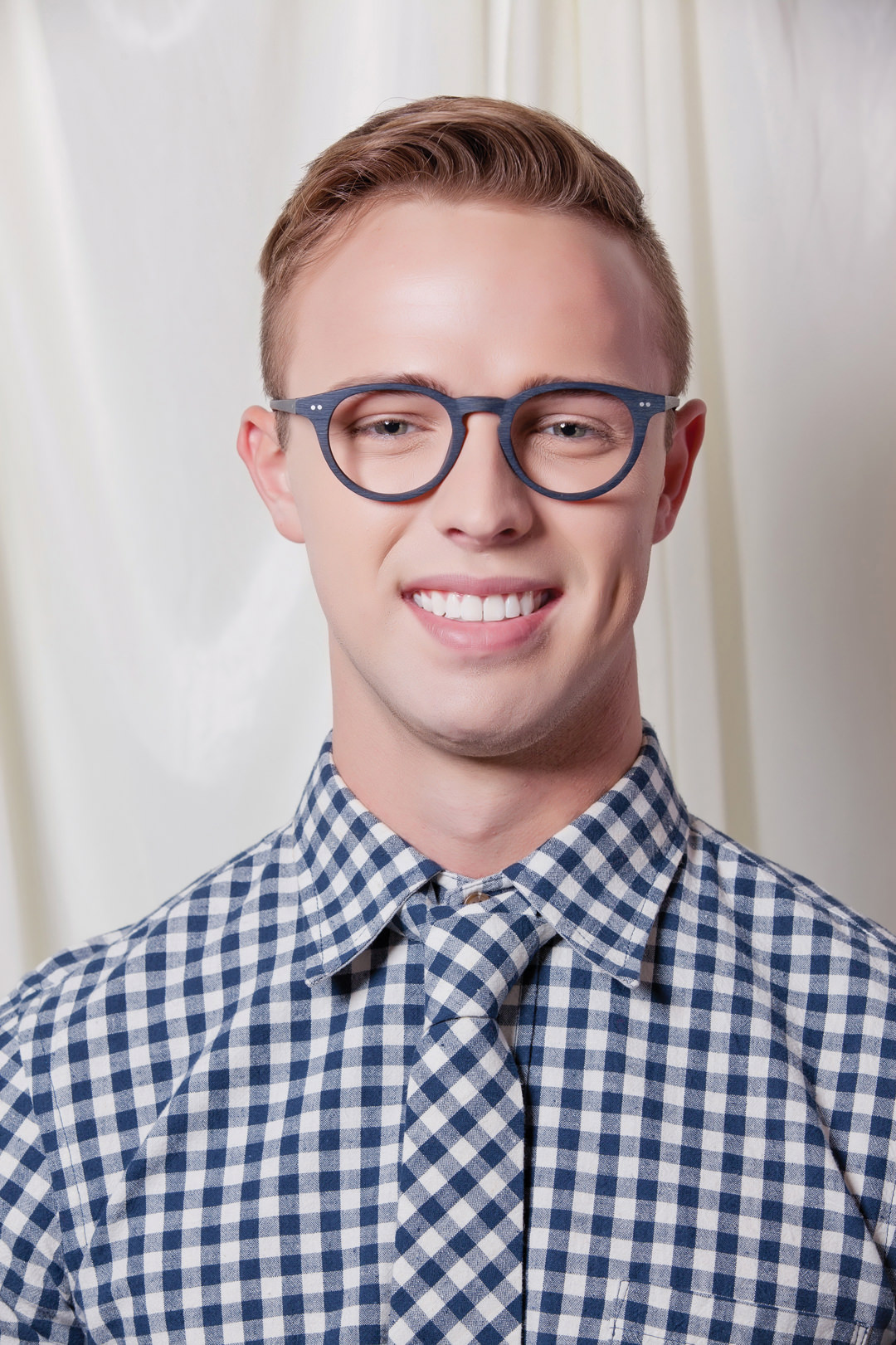 Man wearing Brooklyn Spectacles Kent eyeglasses in Navy.
