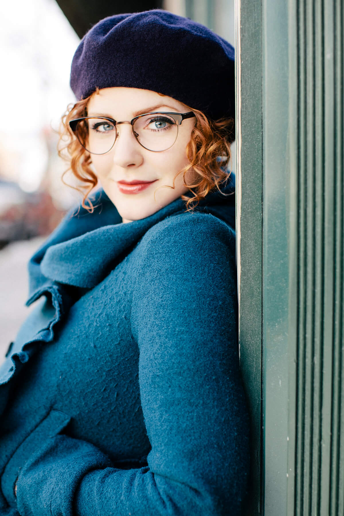 Woman wearing Klein 1991 Ivy metal eyeglass frames in classic tortoise.