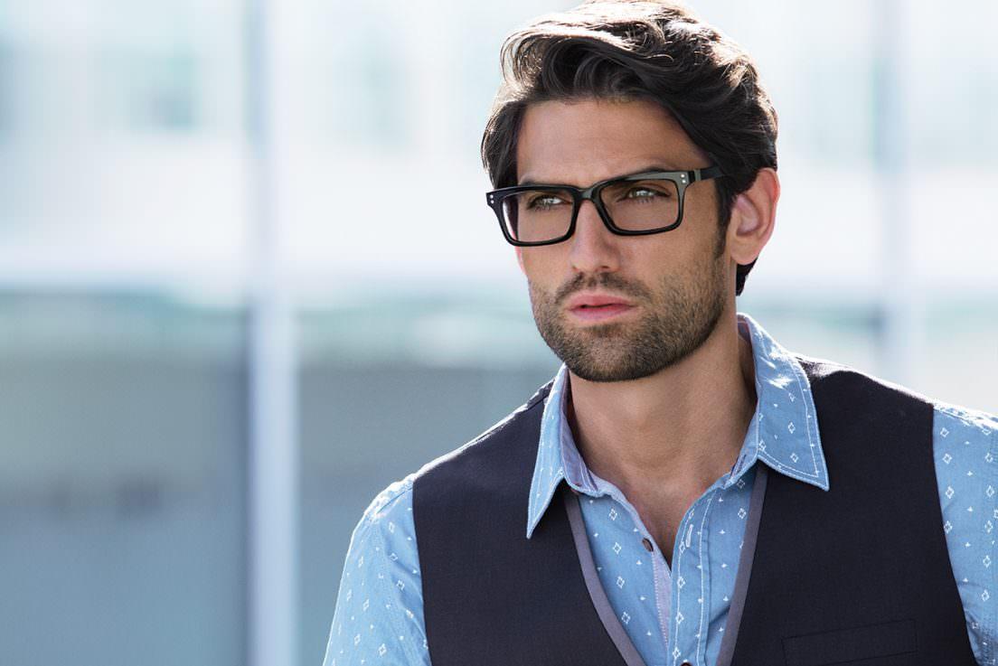 Man wearing EVATIK E-9111 plastic eyeglasses in black.