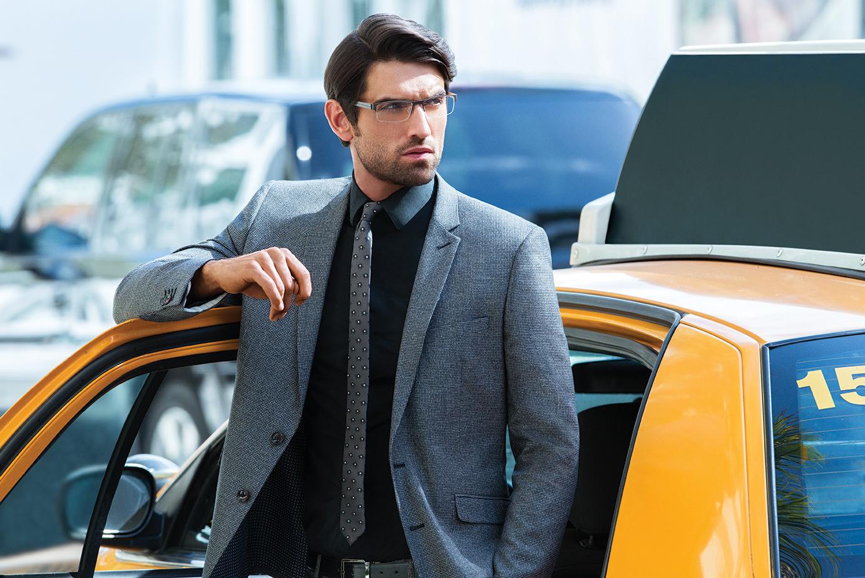 Man wearing EVATIK E-9110 metal eyeglasses in gray/silver.