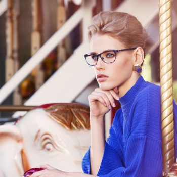 Woman wearing Bellinger Sand-1 metal eyeglasses in purple.