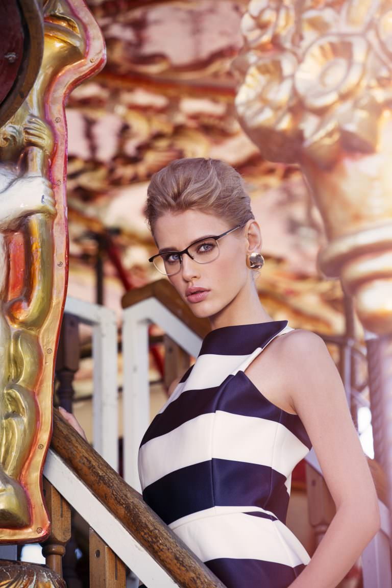 Woman wearing Goldline-4 metal eyeglasses in black/gold.