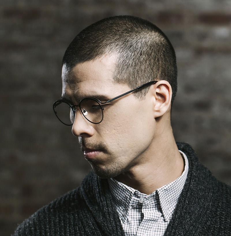 Man wearing KIO YAMATO Noah titanium eyeglasses in mox.