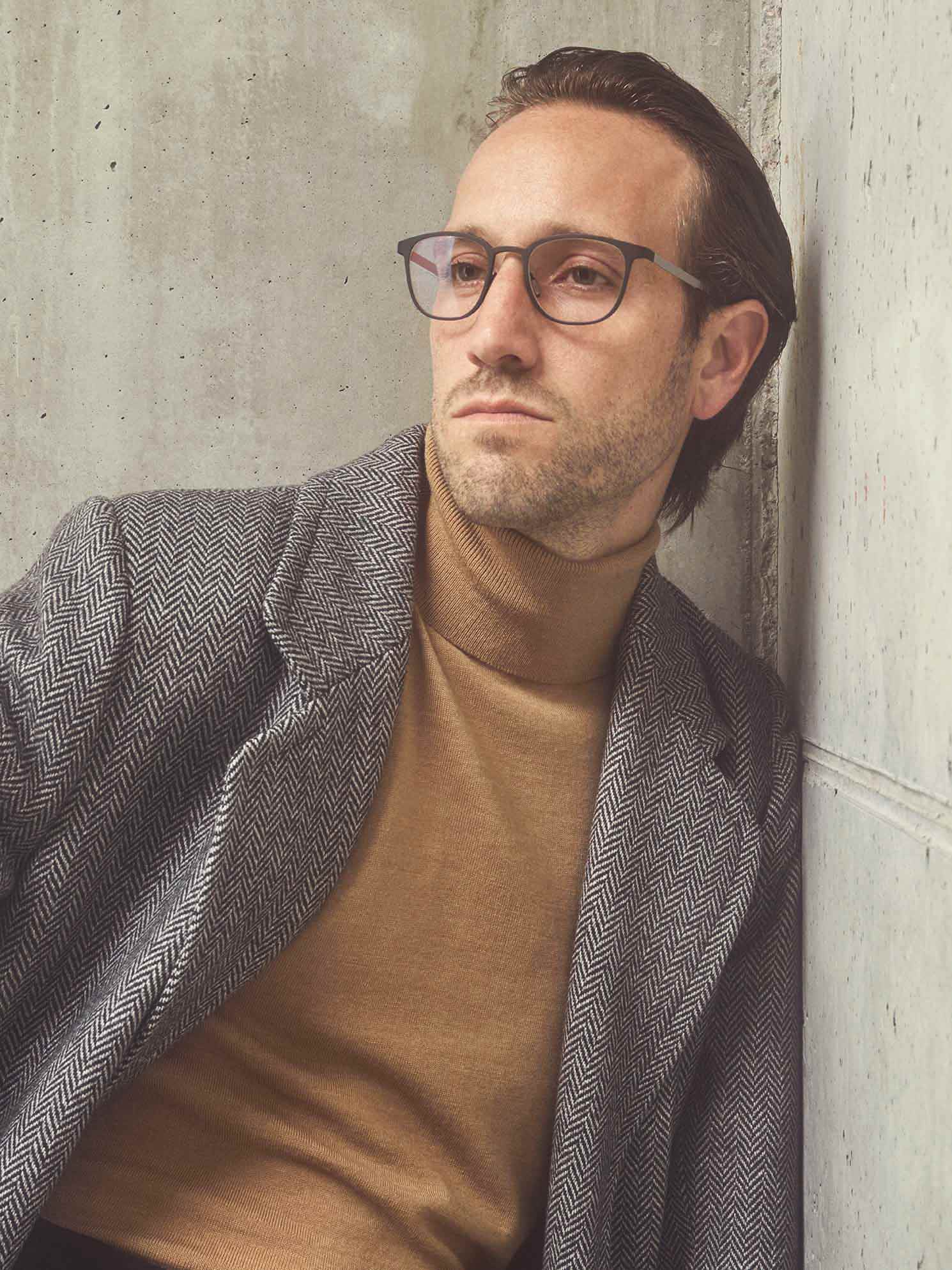 Man wearing Ørgreen Optics Radiant titanium eyeglasses in matte bordeaux/sandblasted titanium.