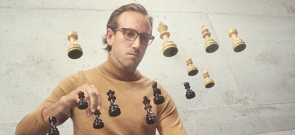 Man wearing Ørgreen Optics Reflector titanium eyeglasses in matte dark rosewood brown/matte teak brown.