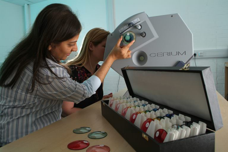 A Colourimetry Specialist performs tests to determine client's optimal filter colour.
