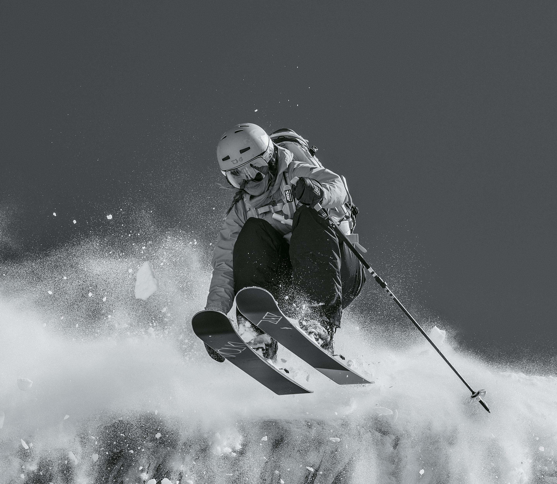 Woman skiing wearing adidas Sport Eyewear Progressor ski goggles.