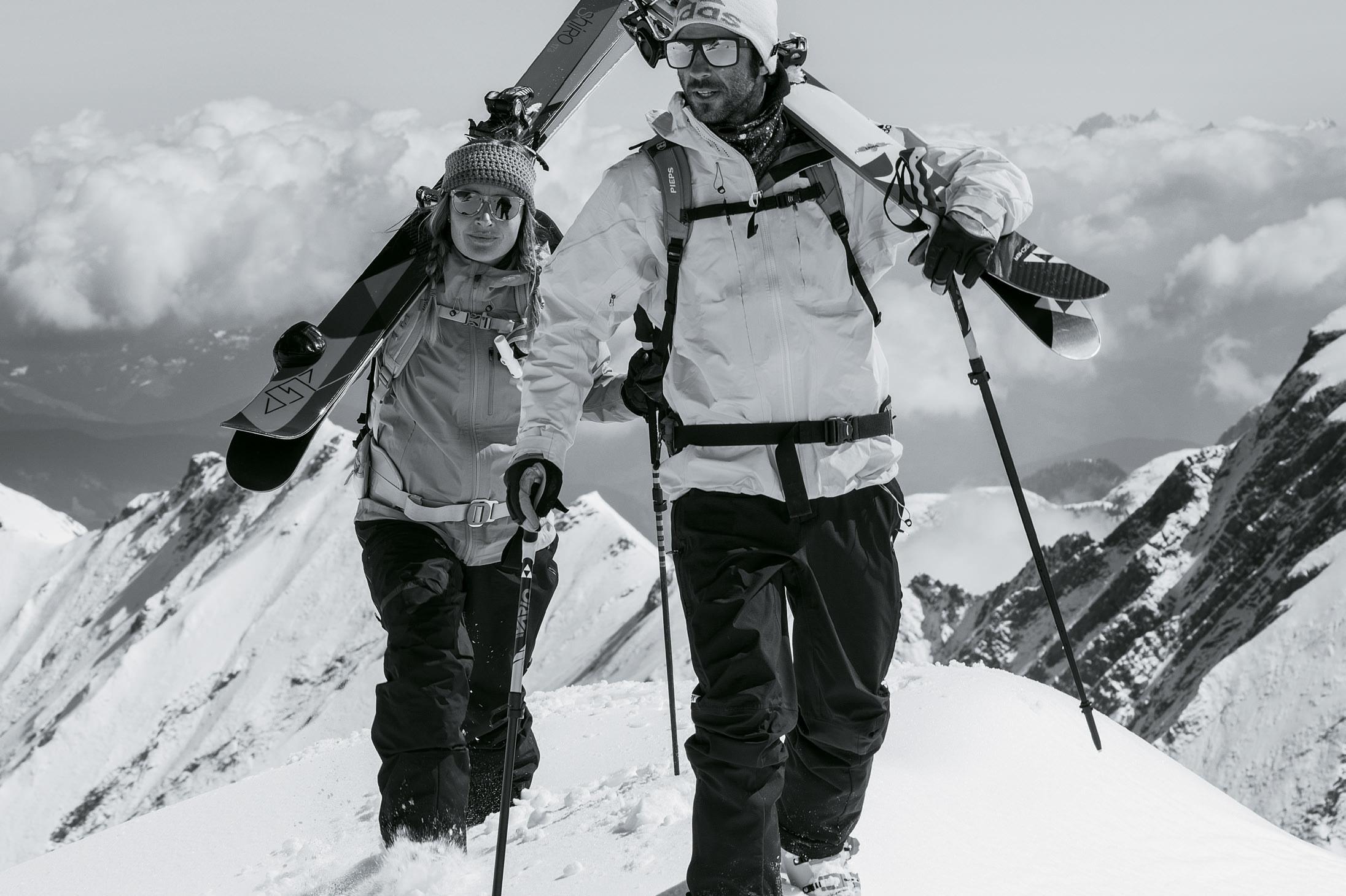 Woman and man climbing mountain wearing adidas Sport Eyewear Wildcharge and 3Matic sunglasses.