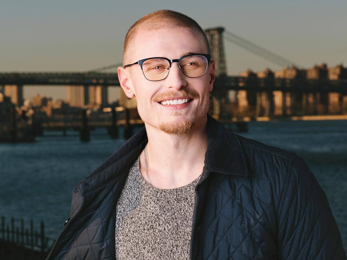 Man wearing O&X NEW YORK Chadwick stainless steel eyeglass frames in Matte Blue.