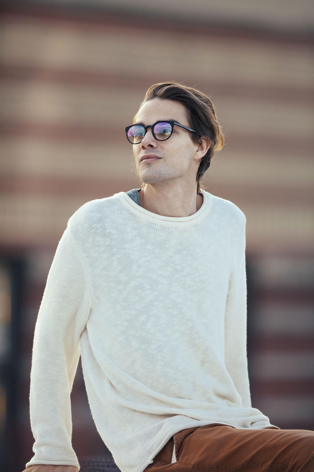 Man wearing O&X NEW YORK Phoenix acetate eyeglass frames in Onyx.