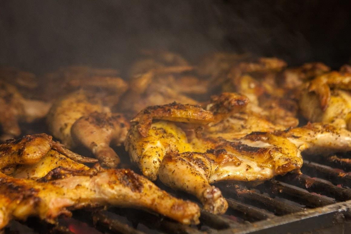 Signature Charcoal Grilled Chicken being cooked at Pili Pili Grilled Chicken.