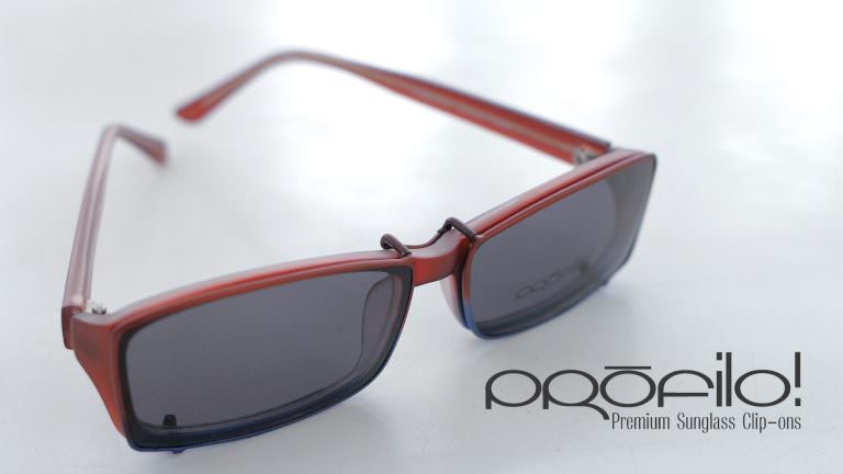 A plastic eyeglass frame fitted with custom PROFILO! Premium sunglass clip-ons.