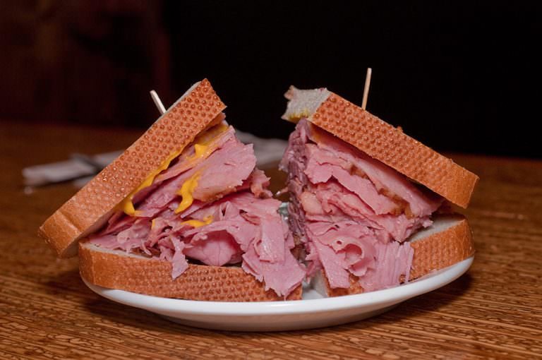 Smoked Meat Sandwich on light rye bread by Dunn's Famous.